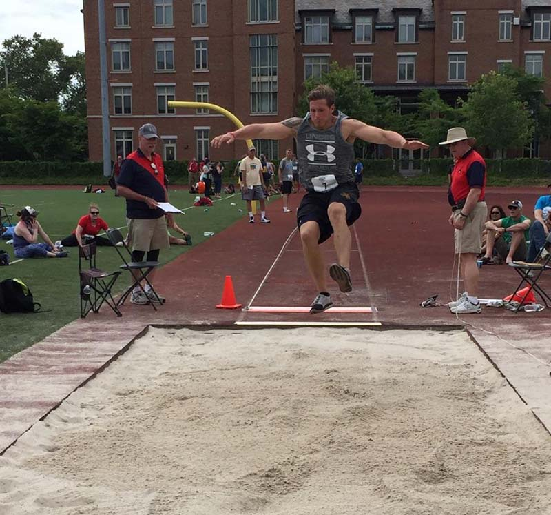Gavin competing in the long-jump